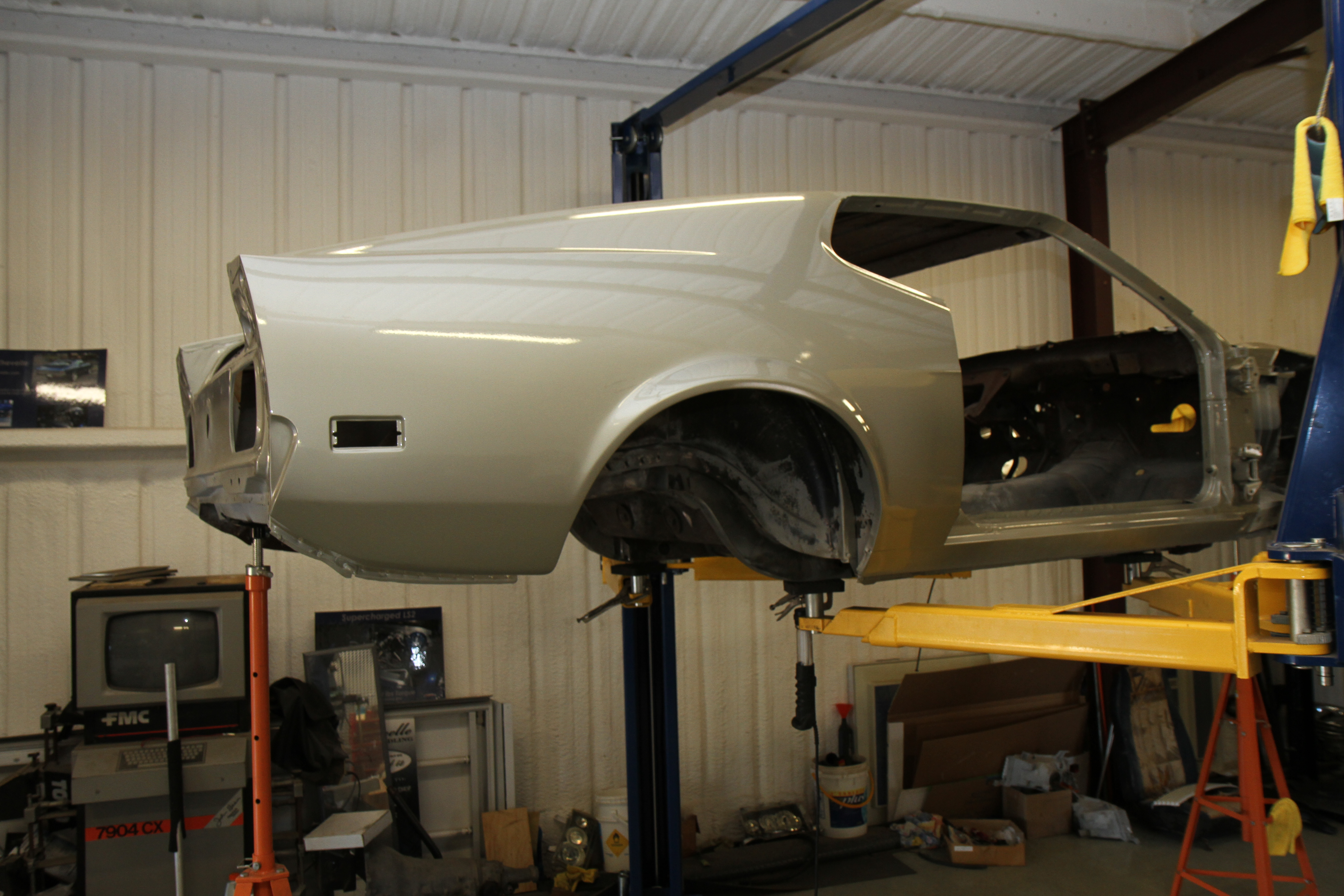 Side view of our 1971 Mach 1 up on the lift starting assembly